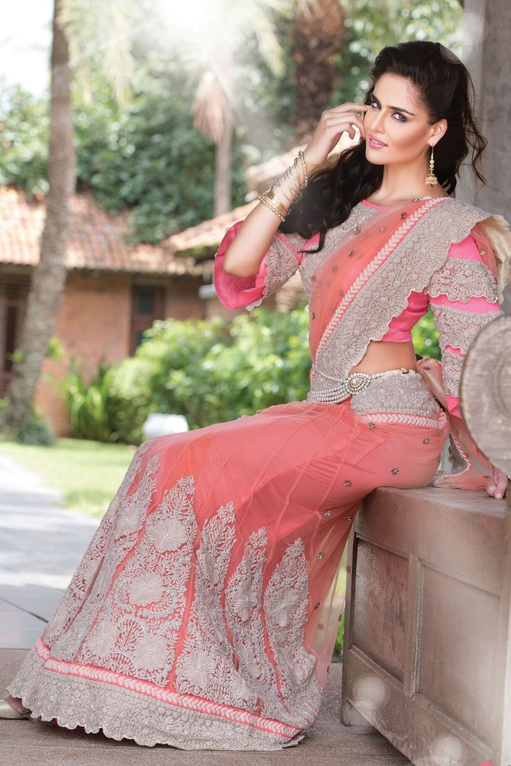 Exclusive Peach net party wear Half and half saree in thread work