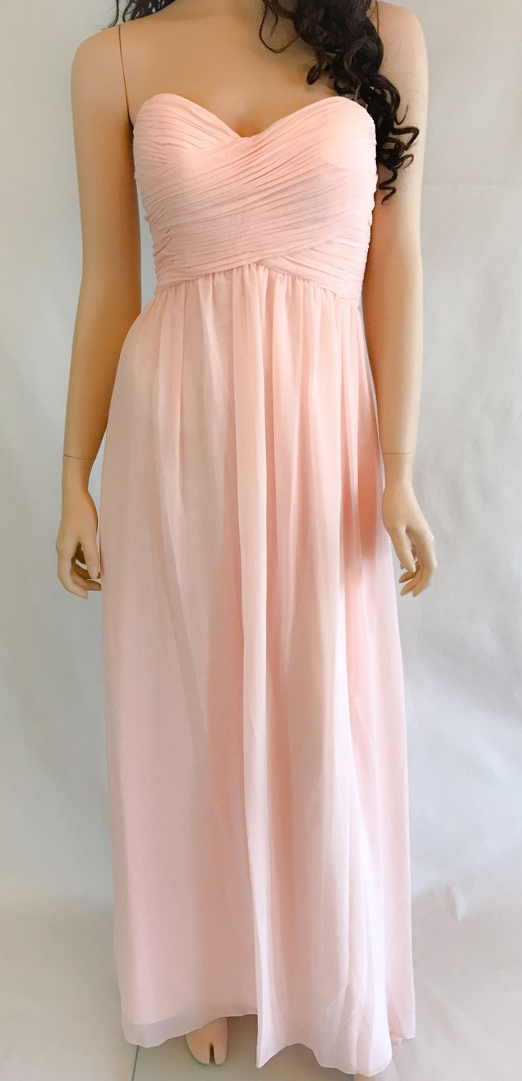 FIRST COMES LOVE BLUSH PINK STRAPLESS MAXI DRESS Endless romance follows wearing this stunning blush pink dress. Chiffon sweeps from a beautiful strapless princess neckline. Lightly padded cups, no sl