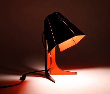 Chibi table lamp origami inspired lamp design produced from a single bent iron sheet designed by hiroshi tsunoda