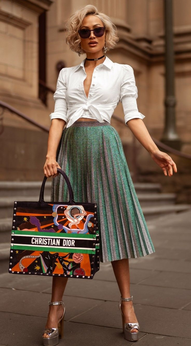 Beautiful green are decent pleated skirt with a white blouse button down. And a …