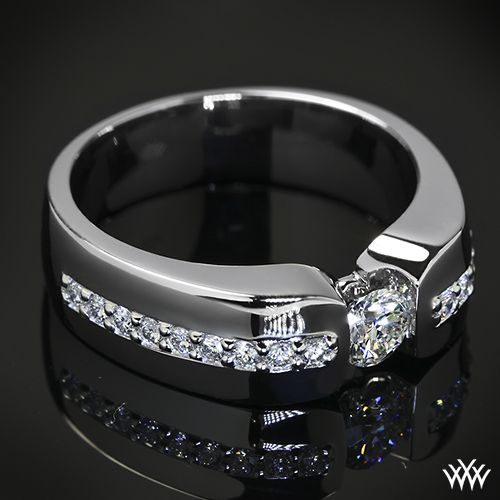 Men deserve diamonds too - This Custom Men's Diamond Wedding Ring is set in Platinum and holds 0.70ctw A CUT ABOVE® Hearts and Arrows Diamond Melee along the shank. The center 0.40ct A CUT ABOVE® Diamond is secured by a half-bezel set.