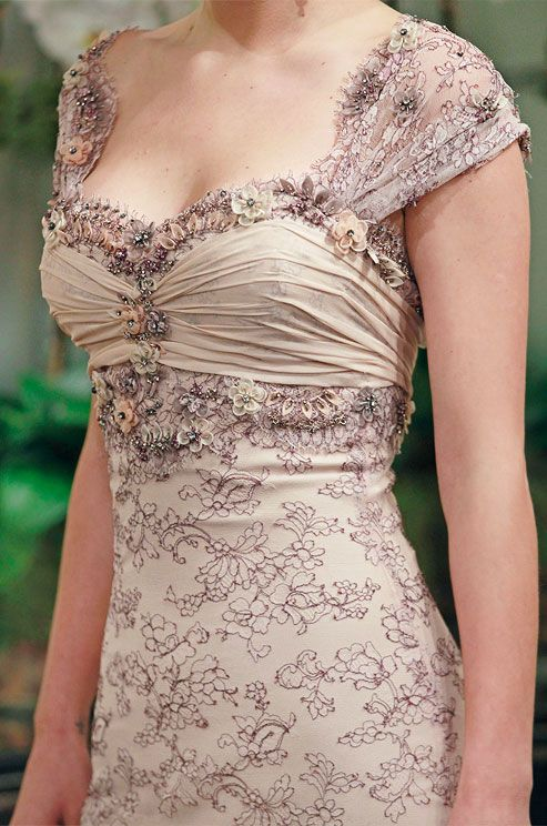 Colored embroidery and beading on a wedding dress by Badgley Mischka, Fall 2013. Click to see the full dress.