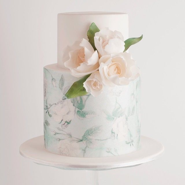 Wintery white and mint palette on this petite wedding cake by Cake Ink ❄️…