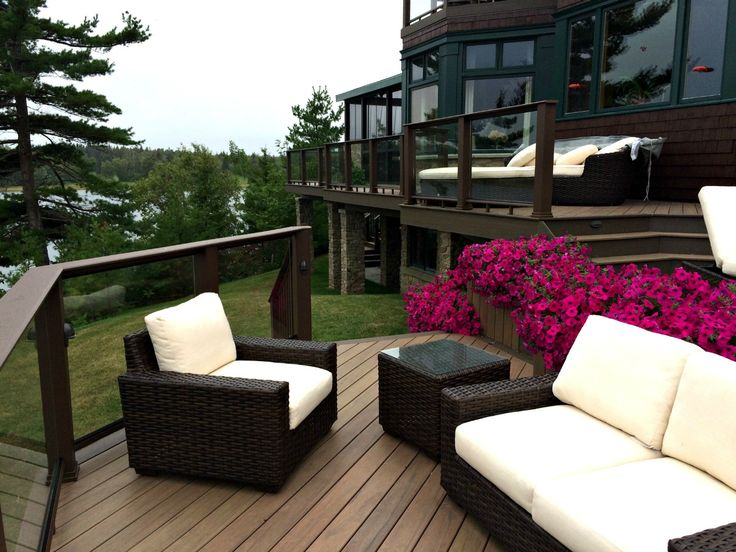 Multi Level Composite Deck with Glass Railing, Screen Porch & Stone Columns. Halifax, NS