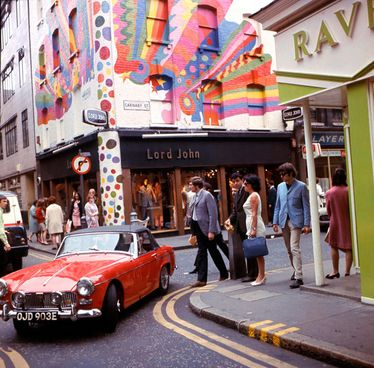 Carnaby Street in colour - doesn't it make you think of Austin Powers? It's since been pedestrianised - you can't drive down this bit anymore. Photo: TopFoto