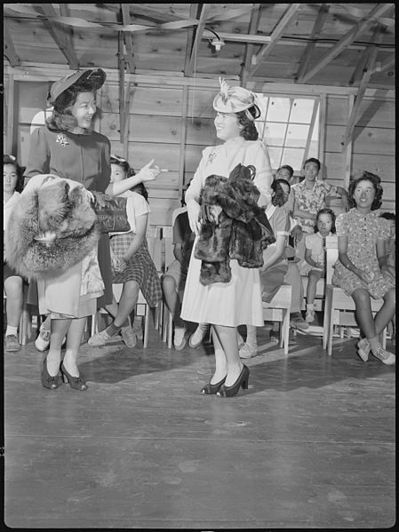 A fashion show, Tule Lake Relocation Center, 7 September 1942, Francis Stewart, public domain via Wikimedia Commons.