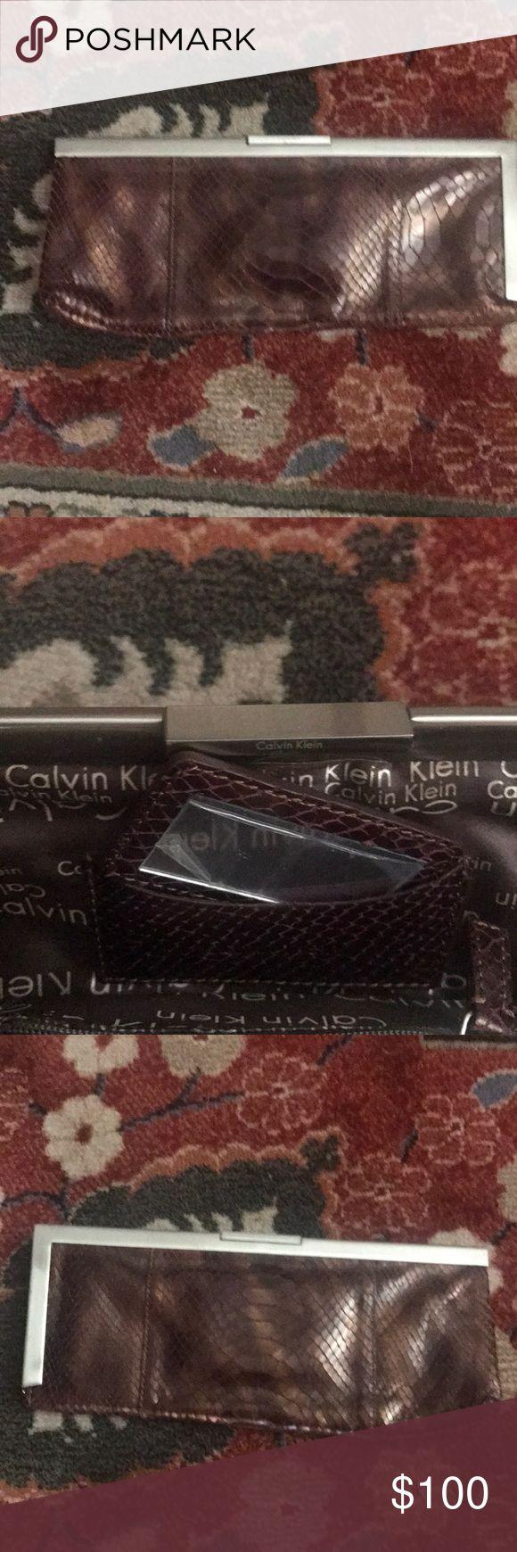 Calvin Klein Metallic Clutch Calvin Klein Metallic Clutch, excellent condition Calvin Klein Bags Clutches & Wristlets