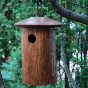 Unusual bluebird house is handcrafted of Mango wood with natural texture to blend with landscape. Sturdy Bluebird House is part of a sustainable and beautifully hand made Mango Tree Collection. The ex