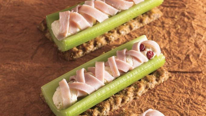 Wrap up Halloween spirit with these crisp celery snacks, with deli ham slices doubling as edible mummy rags.