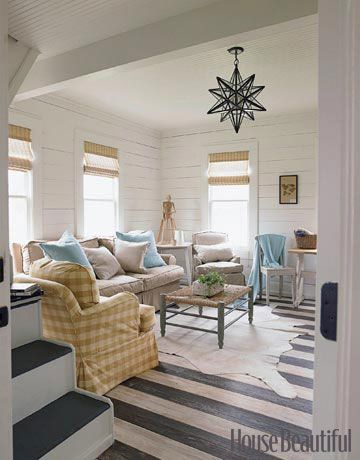 white, planked walls, moravian star pendant, buffalo check, cow hide, layout (Designed by Ginger Barber): Idea, Stars Lights, Living Rooms, Lights Fixtures, Stripes Floors, Beaches Houses, Paintings Floors, Painted Floors, Beaches Cottages