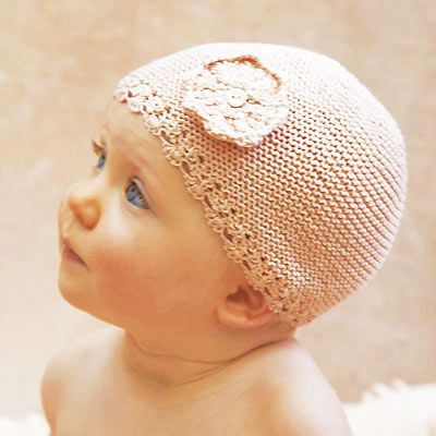 Knitting Patterns For Baby Easy : Baby in a knitted hat free knitting patter for a babies hat by Erika Knight c...