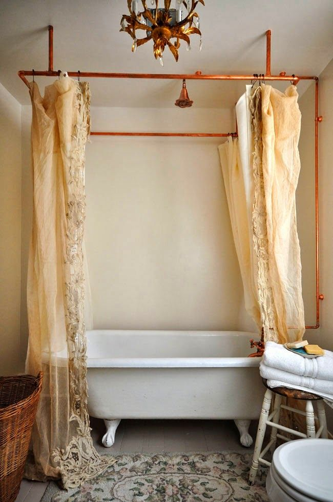 Copper pipe shower curtain rod and vintage bathroom in this gorgeous home tour of Vintage Whites eclecticallyvintage.com