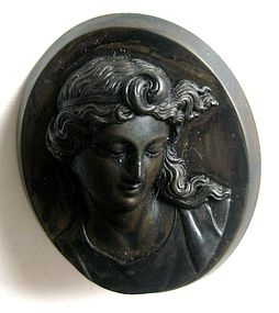 Victorian Gutta Percha Cameo Pin C. 1885 American Gutta percha was used extensively for jewelry production in the mid to late 19th century in both Europe and America. Gutta percha is a resin derived from the dap of the trees in East India.