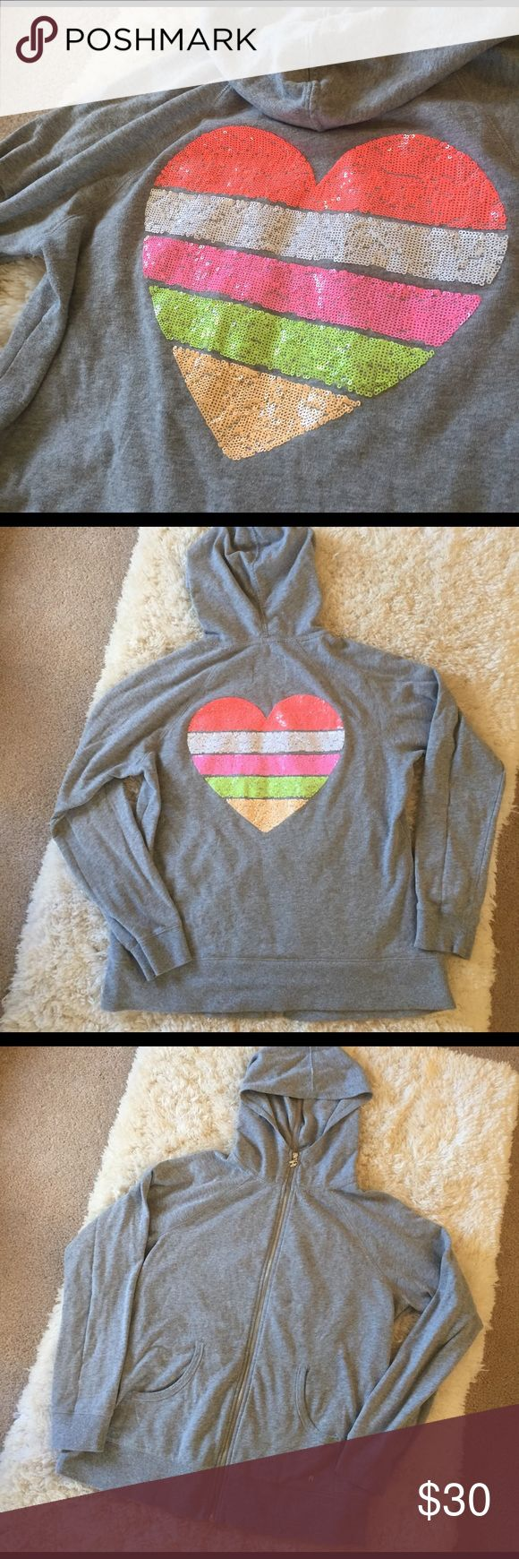 Victoria's Secret Zip Up Hoodie Sequin Heart Fabulous Victoria's Secret zip up hoodie! Very gently used condition. Size XL. Pockets on front. Small silver angel wings logo on pocket and on zipper pull. Back has a huge sequin heart in coral, white, pink, green and orange. So cute and comfortable! Victoria's Secret Tops Sweatshirts & Hoodies