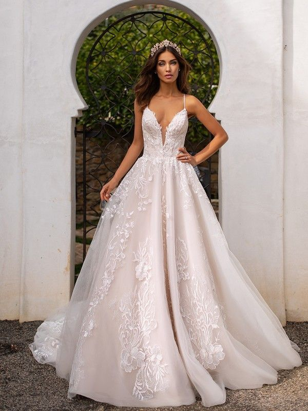 5691f6d19342 Moonlight Couture H1395 is chic and trendy with it's deep illusion v-neck wedding  dress and chapel train. This ball gown includes stunningly detailed ...