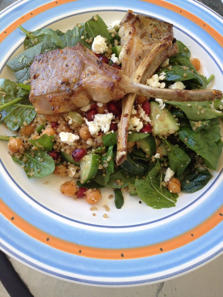 Healthy but indulgent lamb salad. Lamb cutlets marinated in Morrocan spices and grilled served with baby spinach, mint, paprika toasted chickpeas, feta, cucumber and pomegranate.