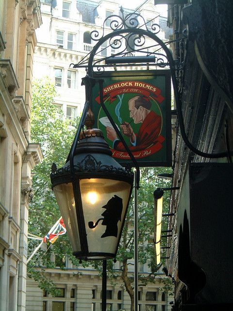 Sherlock Holmes pub sign and lamp in London
