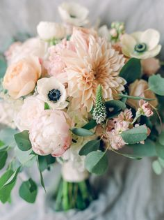rustic elegant anemone, peony, and chrysanthemum wedding bouquet