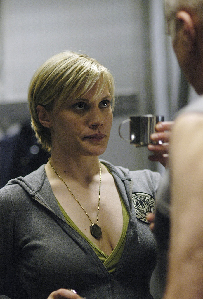 Katee Sackhoff's hair in Battlestar Gallactica.  Lord knows I wouldn't mind looking like her-I did name my dog Starbuck after her BSG character, after all... =o)