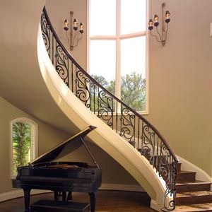 Lovely scrollwork curved staircase reminds me of the one for Blair waldorf apartment