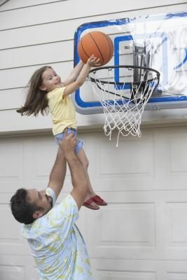 How to Install a Basketball Backboard Over a Garage