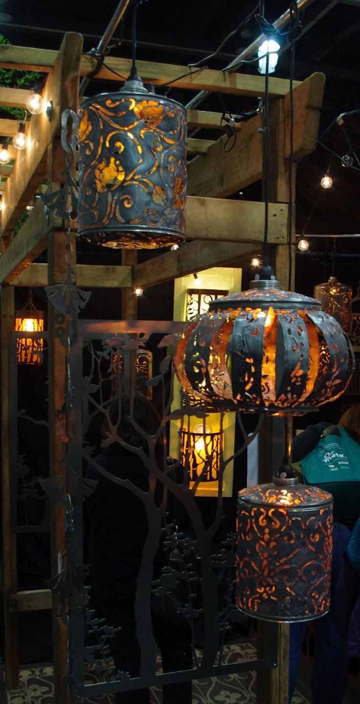 Lanterns...I have 2 of her beautiful hanging lights...the dragonfly and a fern one...love them!!!!