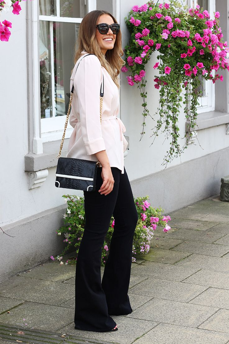 Black Flare Jeans Outfit Worn With Blush Silk Blouse & Cross-Body Bag