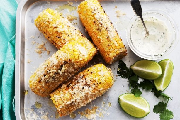 For a tasty summer side, barbecue golden corn, roll in parmesan for cheesy flavour, then dunk in a herb aioli.