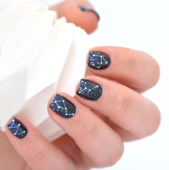 Constellation Manicures Are The Nail Art You Actually Want #refinery29 http://www.refinery29.com/2016/12/131604/constellation-manicures-instagram#slide-1