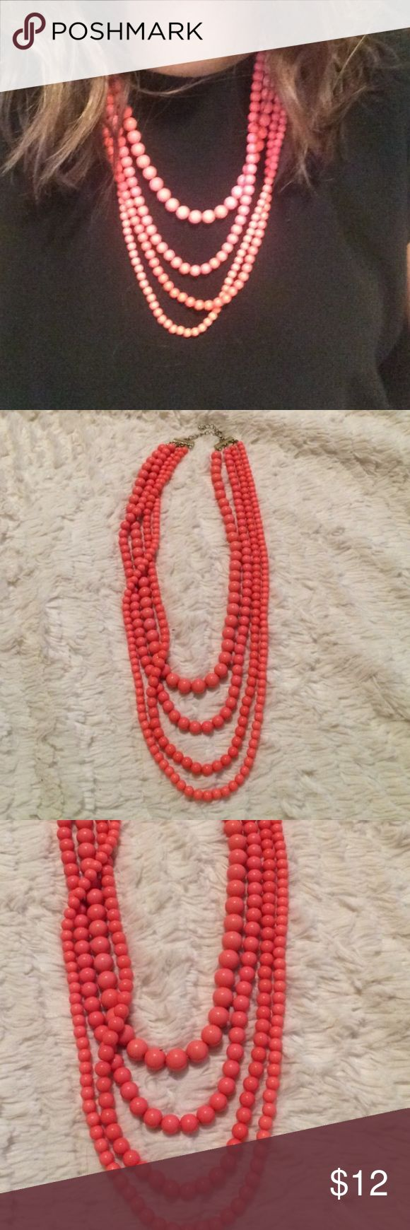 Peach/pink multi strand necklace Such a pretty necklace. Peach/pink color and has 4 strands. Jewelry Necklaces