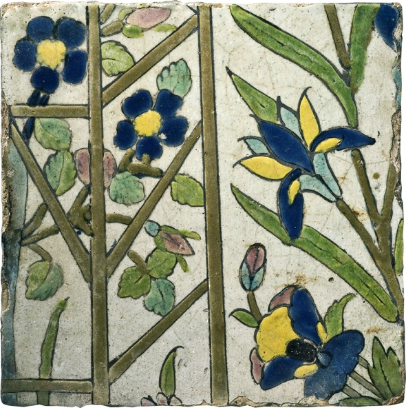 FLOWER TRELLIS - Iran (Safavid), 17th century - A tile in the cuerda seca technique with a charming and unusual design that depicts a hidden corner of a luxuriant, cultivated garden.