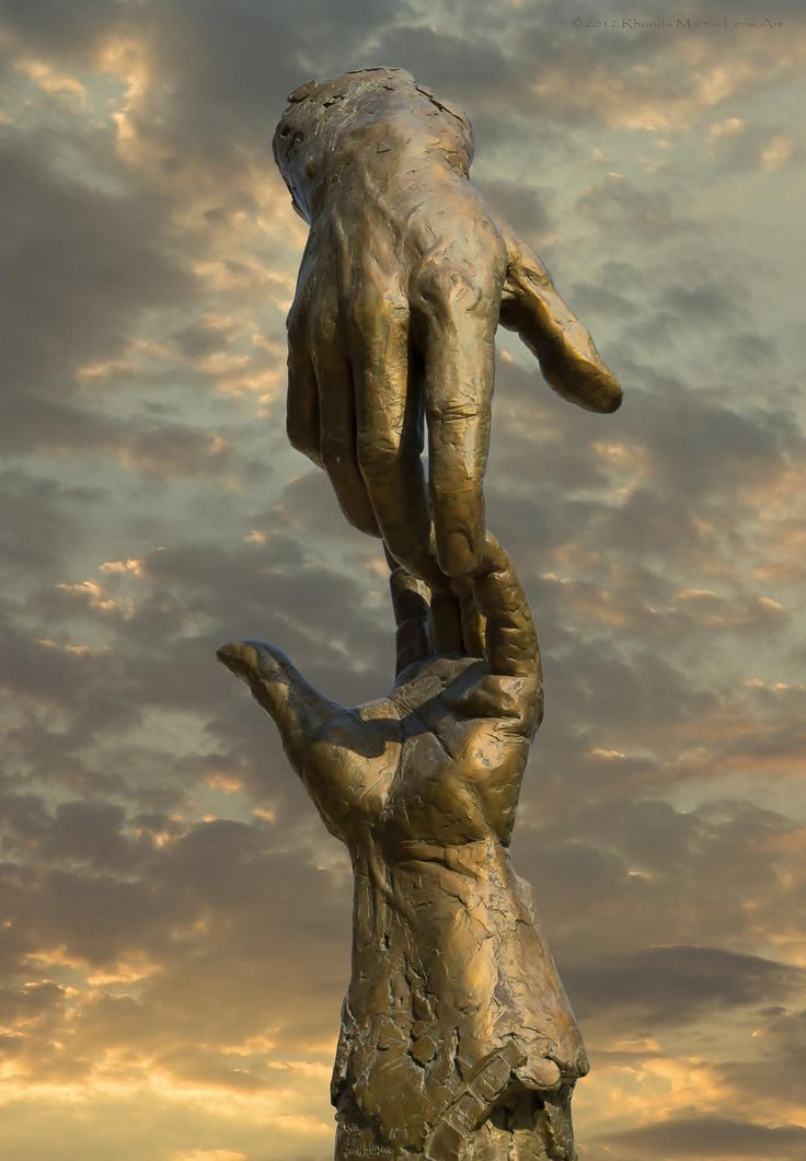 This sculpture is at Hastings College in Hastings, Nebraska. It is a blending of two photos. - Hands: Sculpture by Gary Price