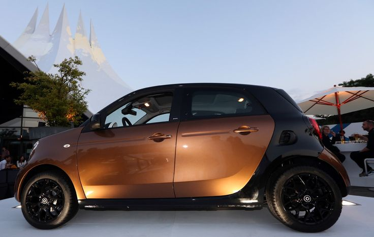 A Smart ForFour car sits on display at the presentation of the latest models of …
