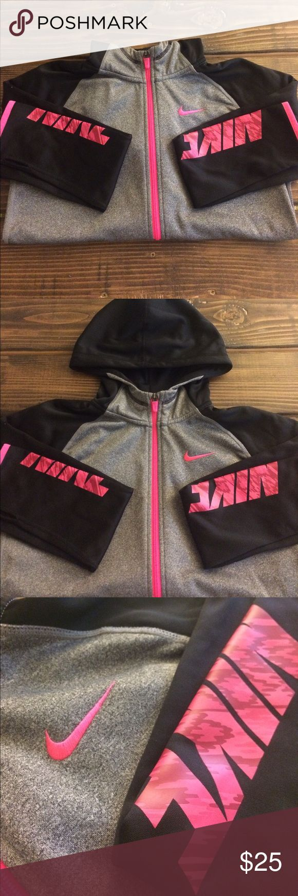 Nike Track Jacket New without tags Nike Dri-Fit Track Jacket. Soft lining. Hot pink accents, black sleeves and hood, heather gray front and back. Nike print on both sleeves. Thumb hole on both sleeves. Double front pockets. Like new! Nike Jackets & Coats