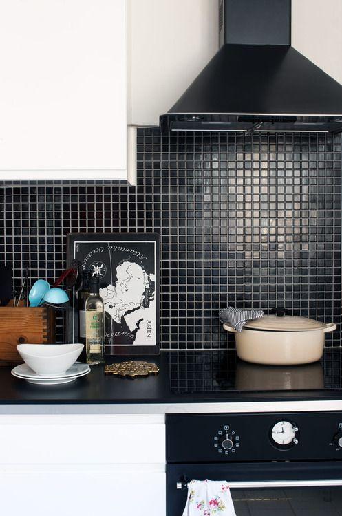 Black tile kitchen backsplash to match black appliances and countertop