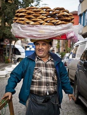 A vendor sells simit, a type of Turkish bread, in the streets of Istanbul: You are sure to find this traditional bread on a FOOD TOUR from Viator (see our guide at http://www.allaboutcuisines.com/food-tours/turkey/in/turkey )or perhaps join a Cooking class from our guide at http://www.allaboutcuisines.com/cooking-school-classes/turkey/in/turkey. #Food Tours Turkey #Turkish Food #Travel Turkey