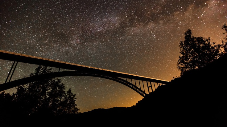 "500px / Photo ""Milky Way over Cold Springs Arc Bridge"" by Björn Freiherr"