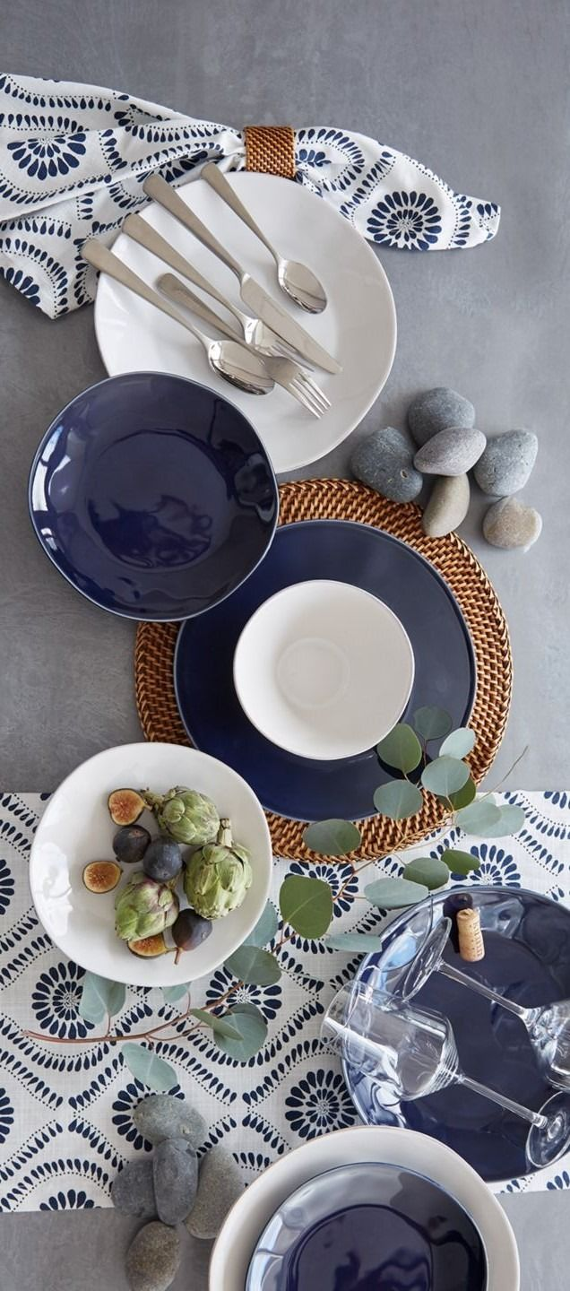 From Portugal, this artisanal dinnerware is crafted of glazed stoneware with subtle hand-antiquing on the freeform rims. Soft, organic shapes bring a warm and welcoming feel to everyday and occasion dining.