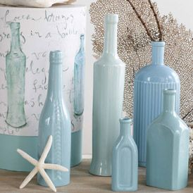 Beach Cottage Decor.  You can take empty bottles, fill with paint, pour out & let dry.
