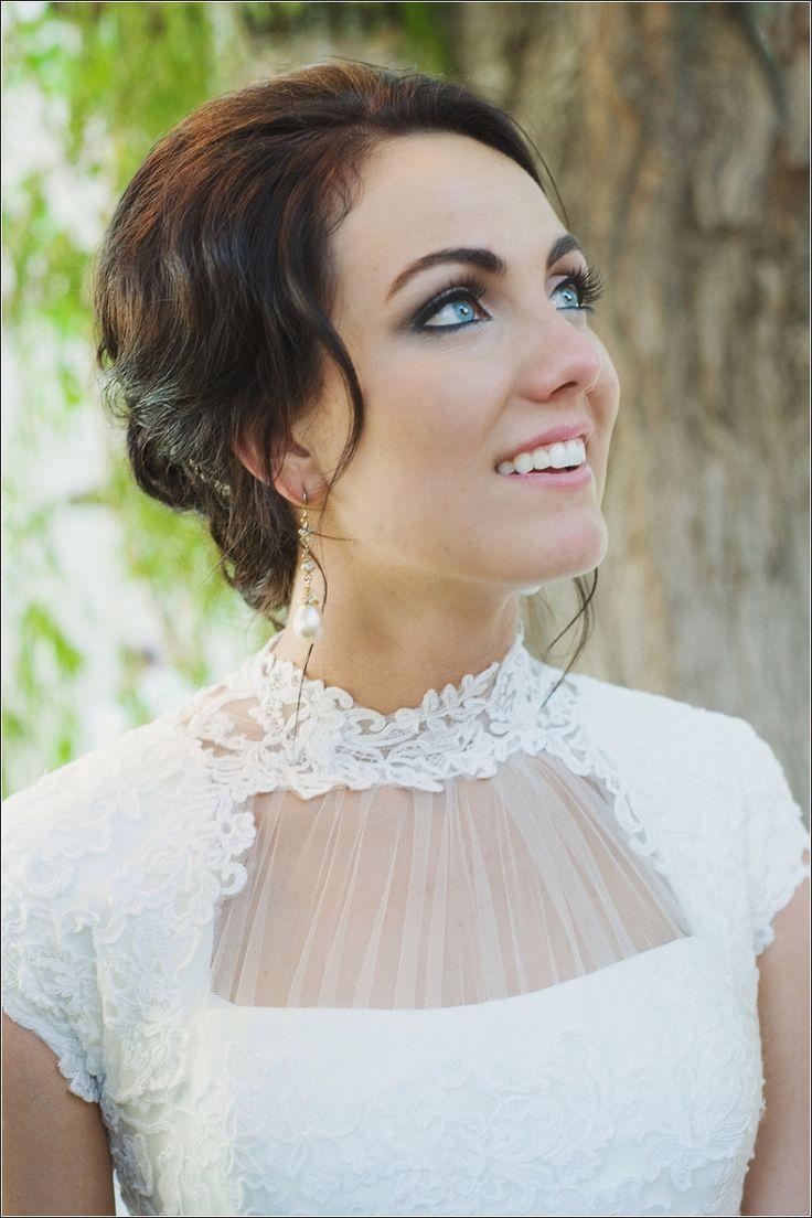 Edwardian high neck modest wedding dress. Lace, mermaid fit from Gateway Bridal.