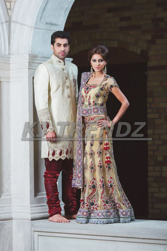 A WEDDING DRESS MUST REFLECT THE  PERSONALITY AND STYLE OF THE BRIDE, SO WHAT BETTER THEN WEARING THE LUXURIOUS COLORS, GOLD AND RED, WHILE MATCHING THE GROOM AT THE SAME TIME.