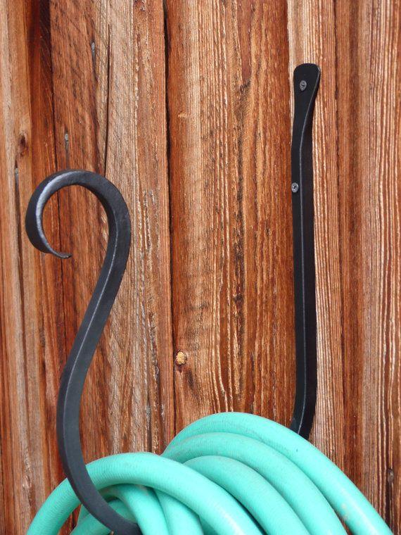 Best 25 garden hose storage ideas on pinterest garden for Garden hose solutions