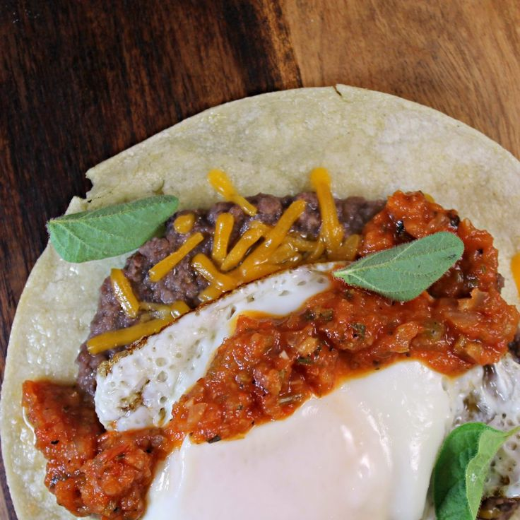 Huevos Rancheros Tacos.  This looks like a great breakfast for dinner option for my Shrinking On A Budget Meal Plan.  Yum!