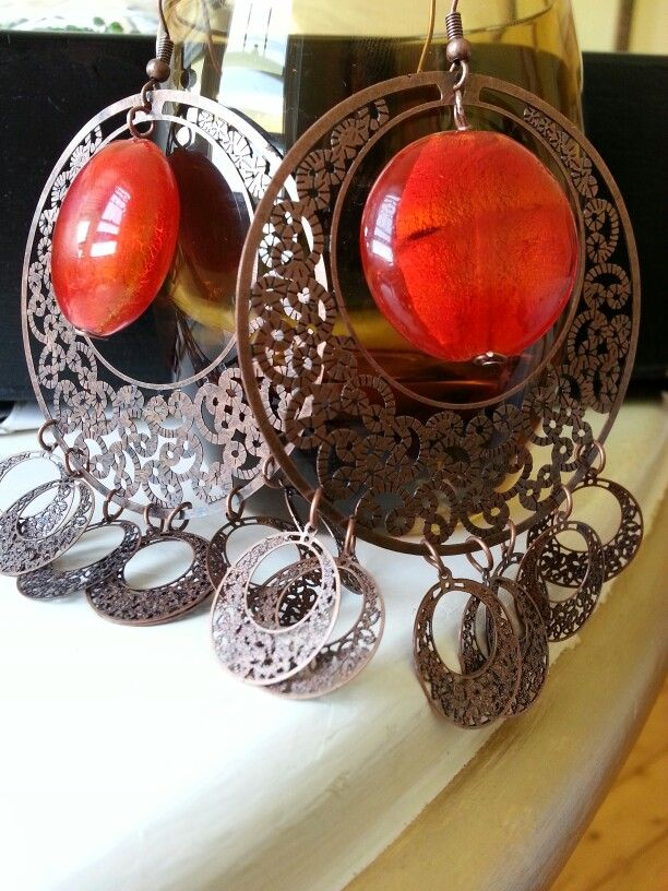 """""""Cherry"""" earrings. Filigree coppertone earrings with large orange foiled glass beads. From Church of Adornment."""