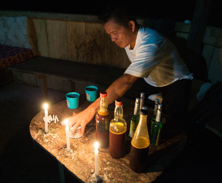 A shaman prepares for an ayahuasca ceremony near Iquitos, Peru.