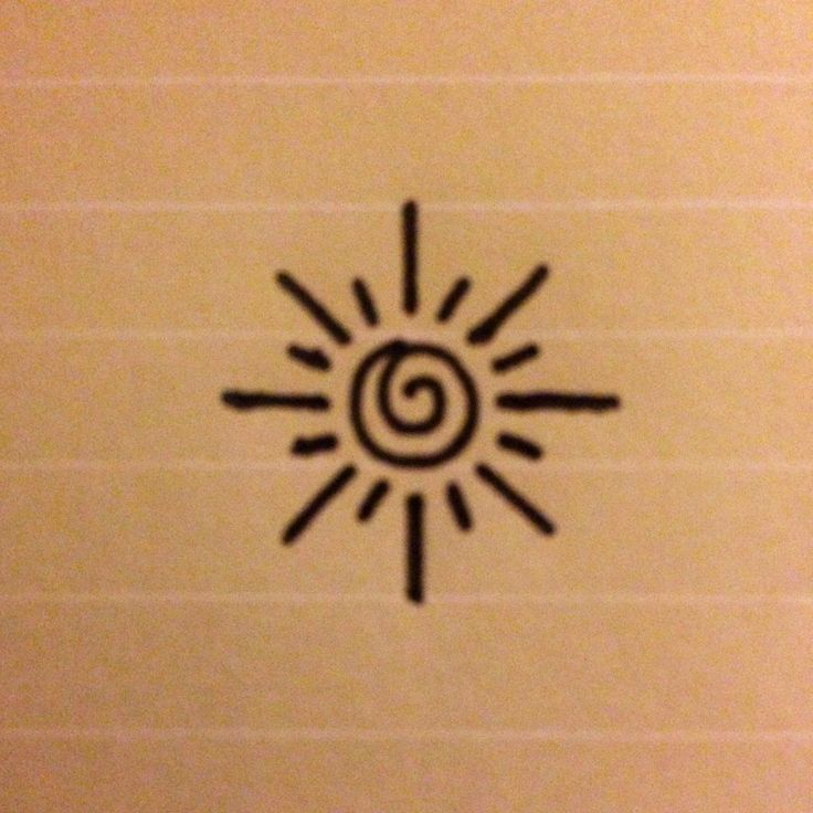This is a small, simple design of a sun - perhaps for an inner ...