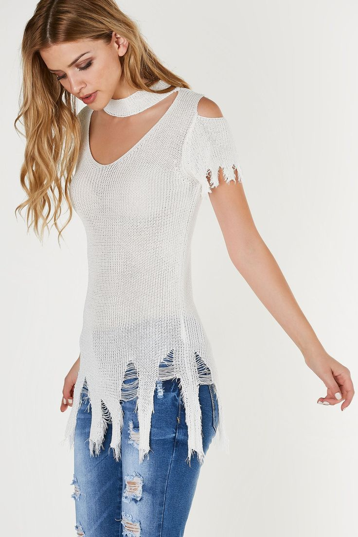 Choker neck short sleeve top with cut out detailing and heavy distressing at hem. Knitted material with relaxed, longline fit. - 100% Viscose - Imported - Model is wearing size S-M - Runs true to size