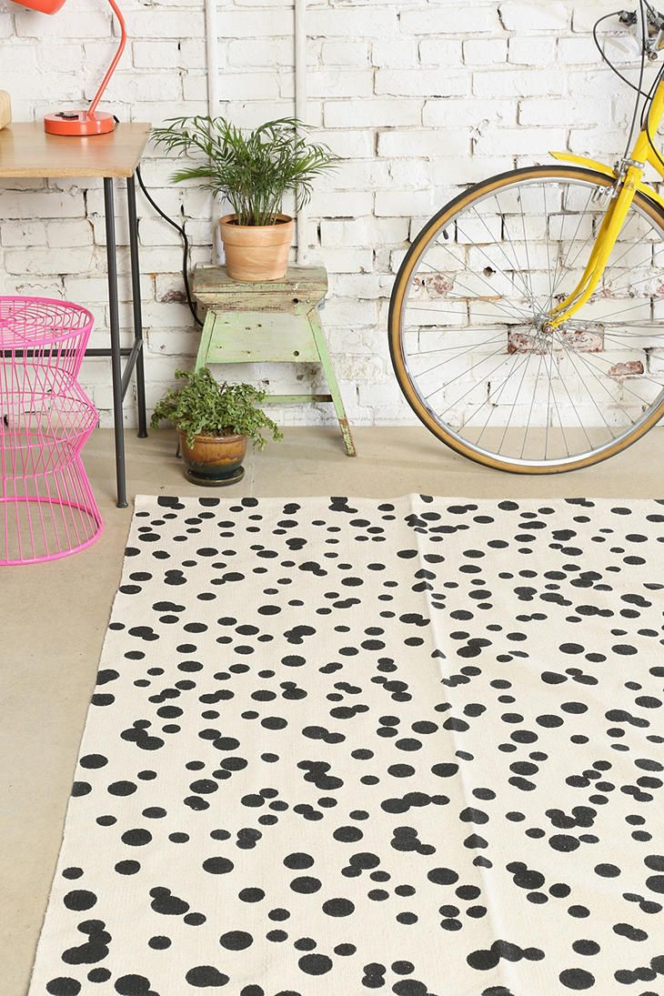 black + white dot rug, I love the idea of using your bike as a feature in the right house, just don't tell my boyfriend!