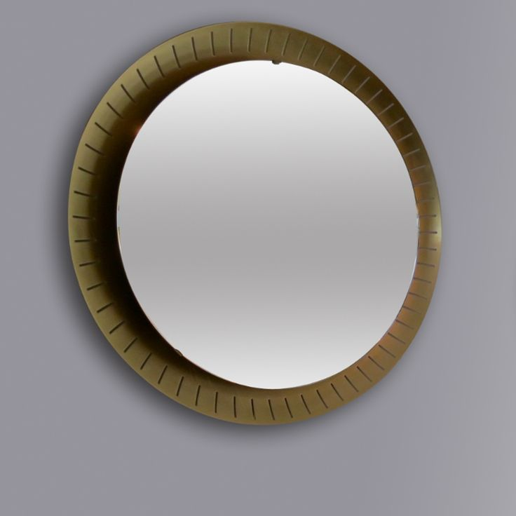 Manufactured by STILNOVO ITALY Circa 1960  Impressive in size and very rare, this mirror manufactured by Stilnovo features a perforated golden aluminum frame and it's back-lit by a circular neon light.  3 available.  SIZE Diameter: 84 cm  STOCK 3 Available