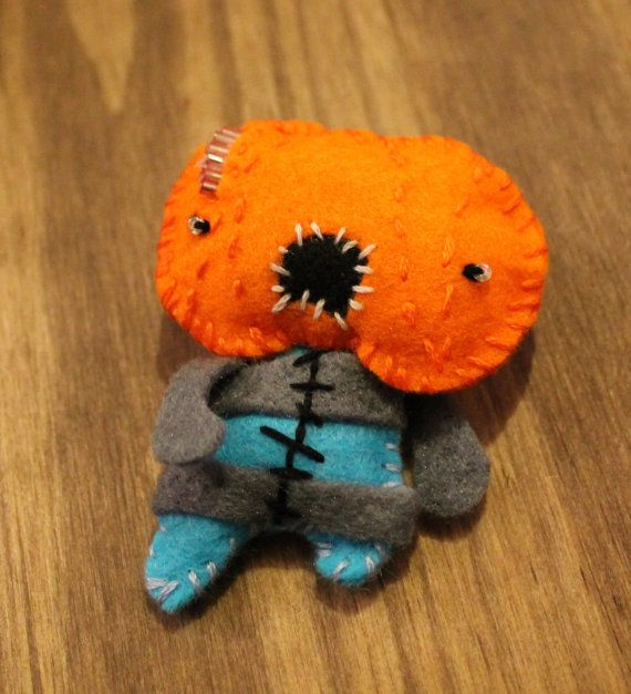 Hey, I found this really awesome Etsy listing at https://www.etsy.com/listing/179988253/zombie-felt-brooch-pumpkin-head-zombie